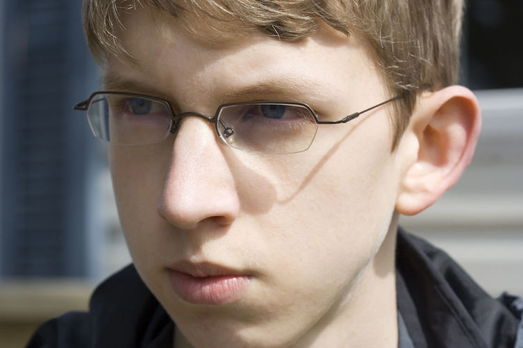 Close-Up Of Teenager Wearing Eyeglasses