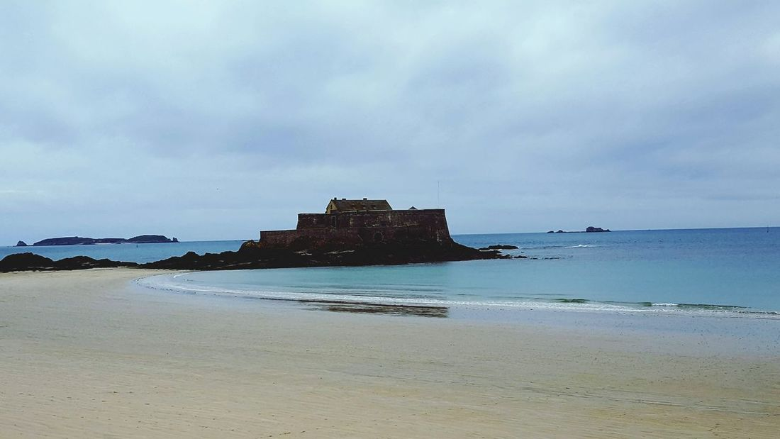 Water Sea Architecture Wave War Beach Cloud - Sky Travel Destinations Built Structure Outdoors History Nature Business Finance And Industry Sky No People Day Sand Tranquility Saint Malo