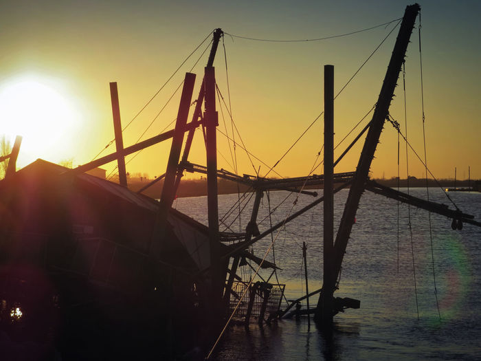 Landscape_photography No People Old Fishing Boat Outdoors River Mouth Silhouette Sunlight Sunset