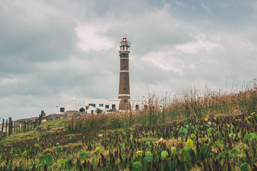 Moody vibes in Cabo Polonio. Cabo Polonio Discovering Grass Latin America Moody Sky Travel Architecture Beauty In Nature Building Exterior Built Structure Cloud - Sky Day Explore Field Grass Gray Landscape Lighthouse Nature No People Outdoors Plant Sky South America Travel Destinations Visual Creativity The Great Outdoors - 2018 EyeEm Awards
