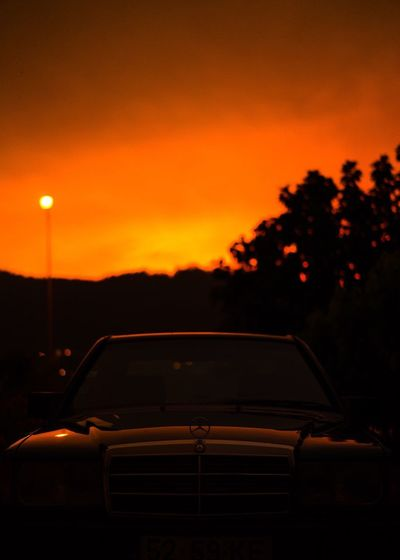 Car Sunset Orange Color Transportation Land Vehicle Mode Of Transport No People Tree Outdoors Nature Sky Close-up Day