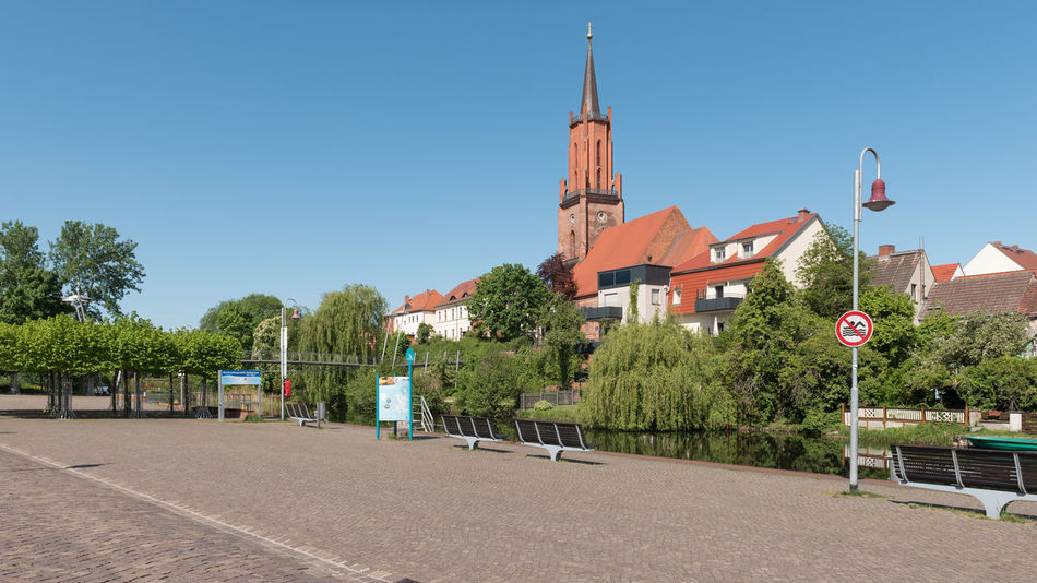 Am Schleusenkanal in Rathenow mit Blick auf die Sankt-Marien-Andreas-Kirche Alter Hafen Havelland Germany Rathenow Stadtkanal Architecture Blue Building Building Exterior Built Structure City Clear Sky Day Footpath Growth Nature No People Outdoors Plant Residential District Road Sky Sunlight Transportation Tree Westhavelland