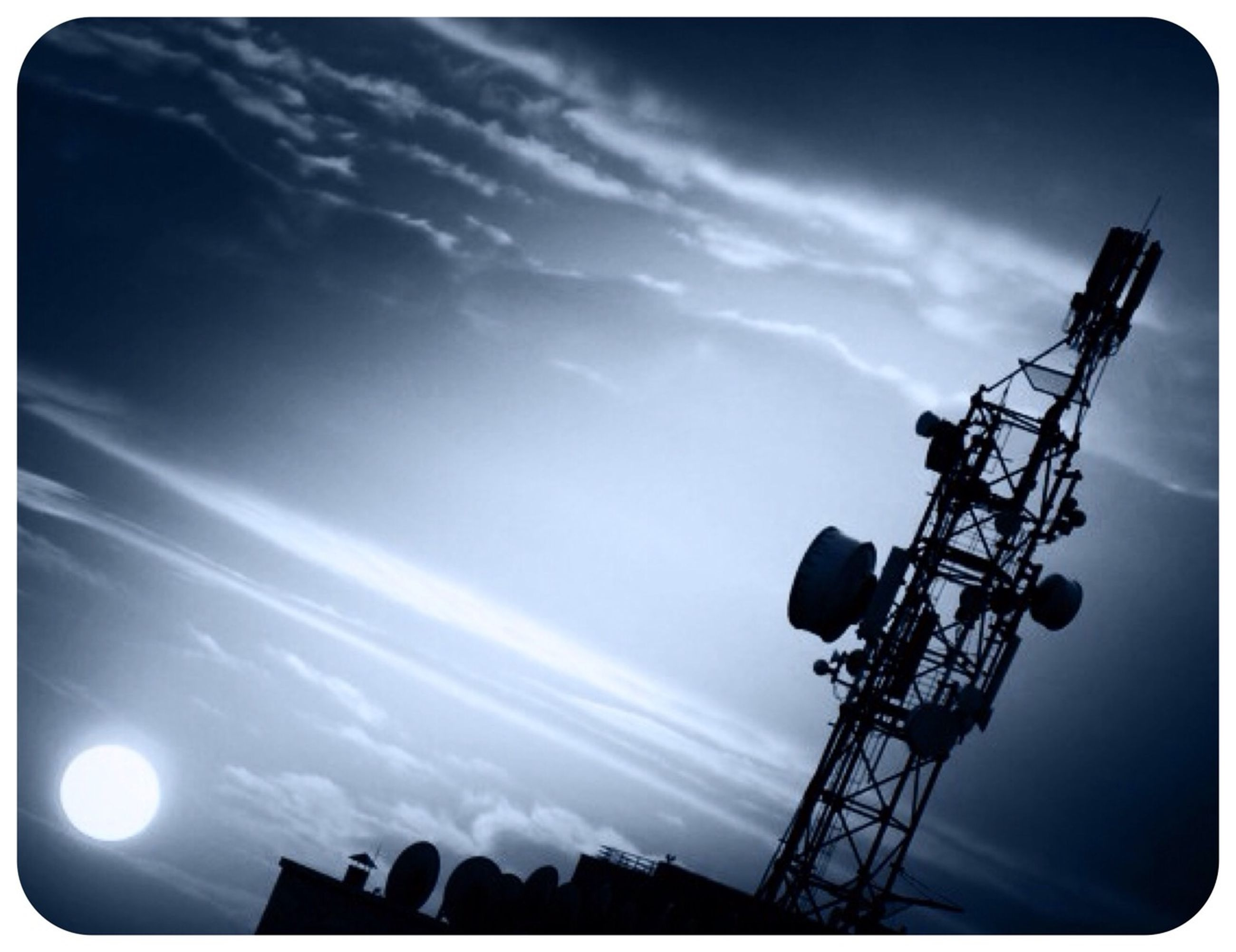 low angle view, sky, transfer print, silhouette, auto post production filter, technology, electricity, cloud - sky, construction site, street light, lighting equipment, fuel and power generation, built structure, crane - construction machinery, electricity pylon, tall - high, industry, cloud, power supply, cloudy