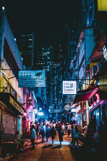 Discoverhongkong Street Photography Nightphotography Nightshooters Building Exterior City Architecture Built Structure Group Of People Real People Street Large Group Of People Night Illuminated City Life Transportation Advertisement Crowd Building City Street Communication Lifestyles Men Text