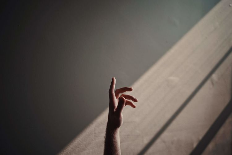 Shadow of person hand on wall