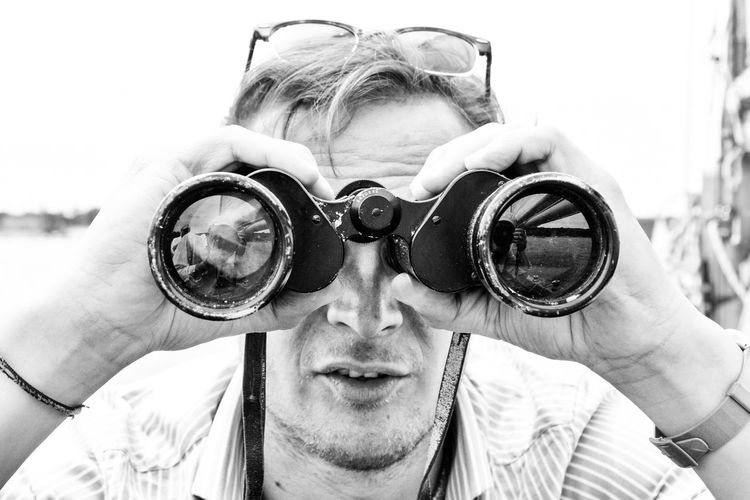 Close-Up Of Tourist Using Binoculars