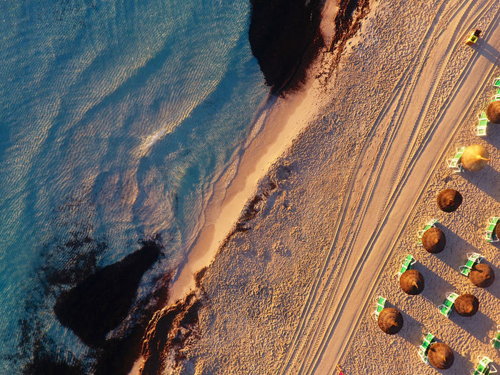 Aerial view of beach at sunset