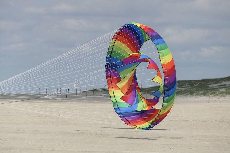 Multi colored umbrella on beach