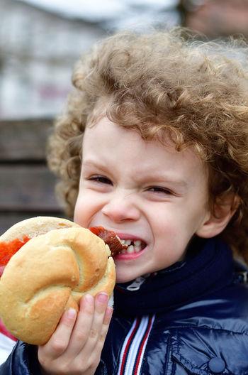 Close-Up Portrait Of Boy Eating Burger