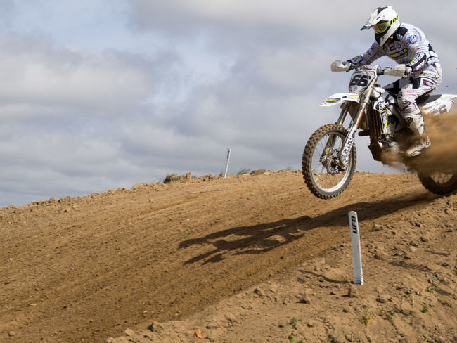 Adventure Competition Competitive Sport Day Extreme Sports Helmet Men Mid-air Motocross Motorcycle Motorcycle Racing Motorsport Off-road Vehicle One Person Outdoors Real People Riding RISK Sand Skill  Sport Sports Clothing Sports Race Sports Track Stunt