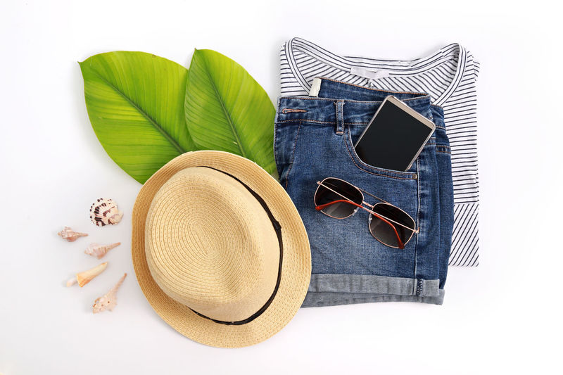 Women modern fashion clothes and accessories. Flat lay female casual style look. Top view Boutique Camera Casual Collage Fashion Feminine  Hat Jeans Shoe Shopping Beauty Blouse Cloth Female Jacket Lifestyles Minimal Shop Straw Hat Style Summer Sunglasses Travel Accessories Trend Women