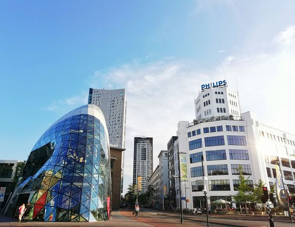 Architecture of Eindhoven in 18 September plaza Architecture Dutch Urban Style Landmark Travel Destinations Streetphotography Sunset Europe Trip European  Building Exterior Building Exterior City Skyscraper Modern Illuminated Sky Architecture Building Exterior Built Structure Office Building Tall - High Communications Tower Urban Skyline Cityscape Financial District  Park - Man Made Space Town Square Building Story Skyline