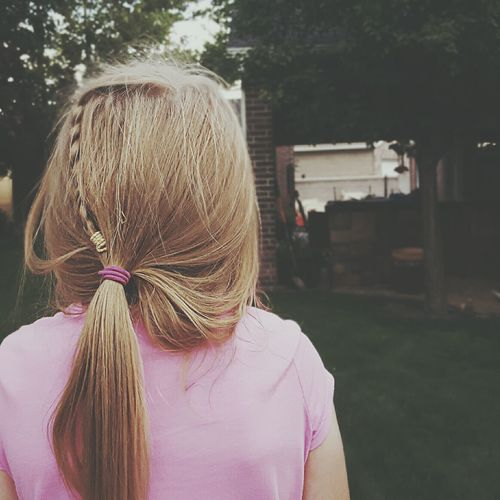 Rear view of girl with long blond hair