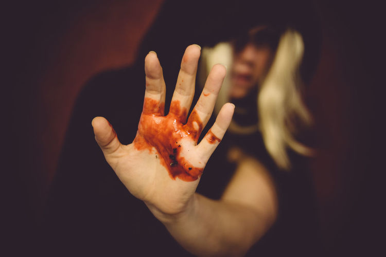 Bleeding Blood Cloaked Figure Dark Disturbing Fingers Focus On Foreground Hand Hands Holding Out Hand Human Body Part Human Finger Human Hand Hurt Injury Moody One Person Pain Palm Palm Out Shocking Unrecognizable Person Woman Wound Wounded