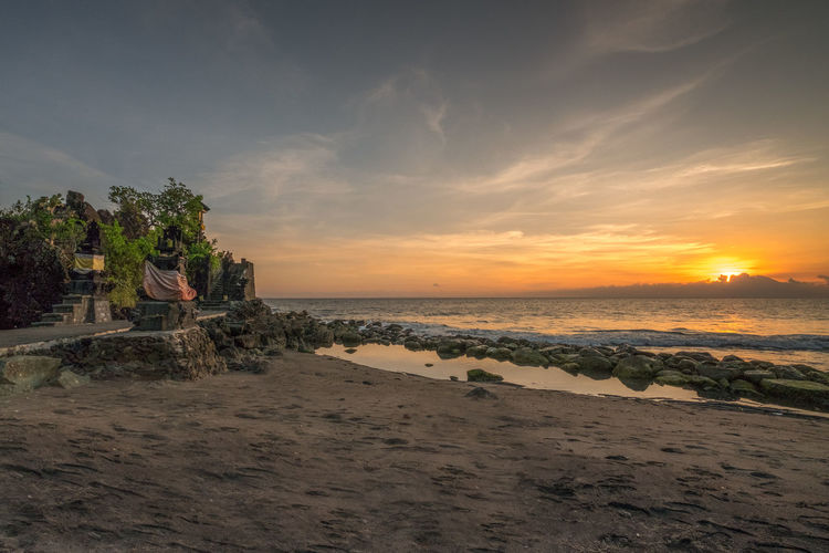 Enjoy the sunset Water Sea Beach Sky Land Sunset Sand Cloud - Sky Beauty In Nature Horizon Scenics - Nature Nature Horizon Over Water Tranquility Tranquil Scene No People Tree Outdoors Plant Batu Bolong Temple Lombok-Indonesia Temple