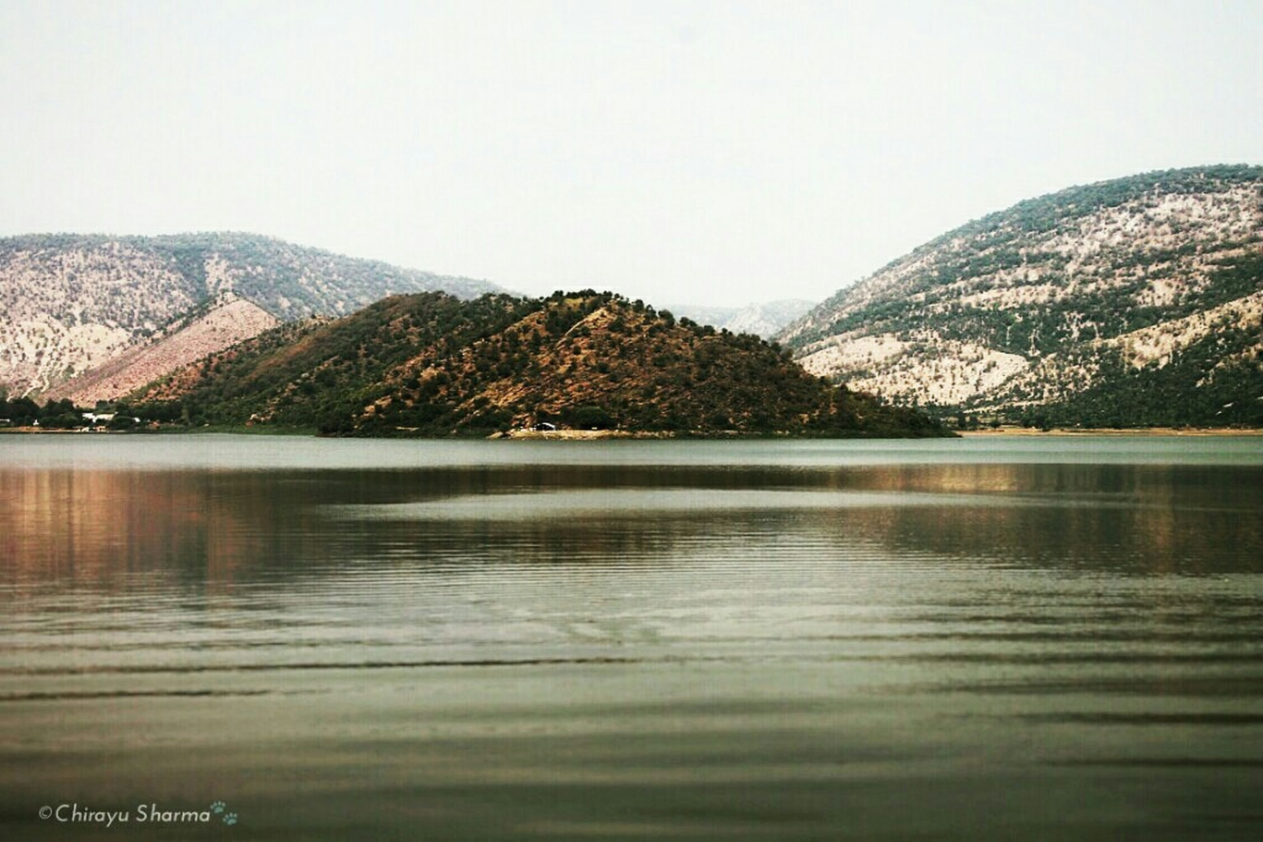 water, mountain, clear sky, tranquil scene, scenics, tranquility, waterfront, lake, beauty in nature, copy space, mountain range, nature, reflection, river, idyllic, no people, outdoors, day, sky, sea