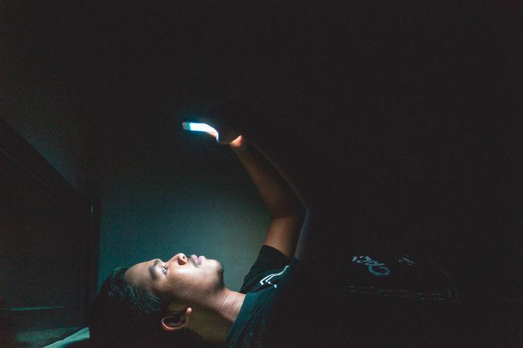 Reflection of man on illuminated light painting