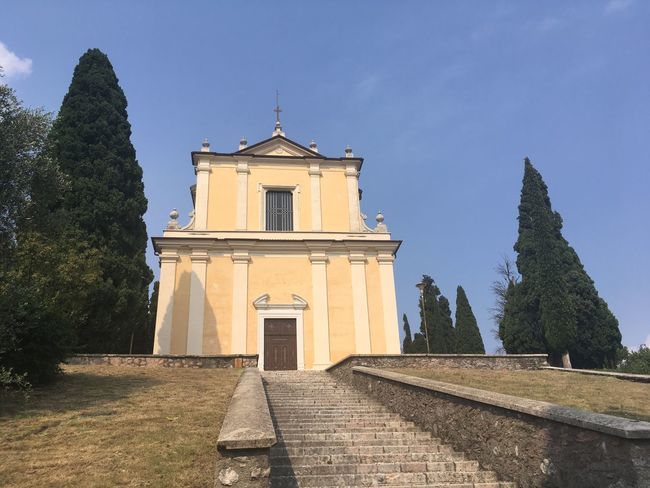 A short walk to the church to have then a wonderful view of the lake Garda look for my other pictures about it Chiesa Cecina  Toscolano Maderno Lake Garda Italy Church Architecture Architecture Built Structure Sky Belief Religion Place Of Worship Tree Outdoors Spirituality