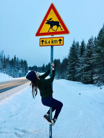 Life it's too short to take it seriously Be a Reindeer Winter Snow Finland Reindeer One Person Full Length Nature Tree Sign Real People Day Road Lifestyles