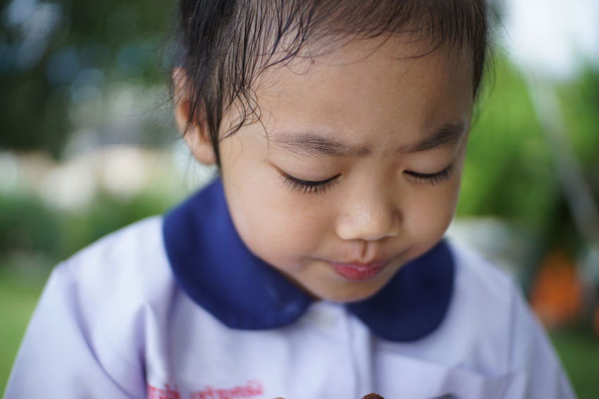 Khwan Khaw after school. Student Thai Thailand After School Child Childhood Close-up Cute Day Focus On Foreground Front View Girl Girls Headshot Human Face Innocence Kid Leisure Activity Lifestyles Looking Down Men One Person Outdoors Portrait Real People Student Uniform Unifrom Young Adult The Portraitist - 2018 EyeEm Awards The Fashion Photographer - 2018 EyeEm Awards The Still Life Photographer - 2018 EyeEm Awards