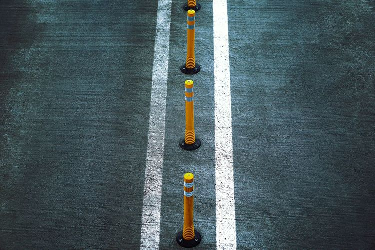 Textured  Backgrounds No People Yellow Streetphotography High Angle View Low Section Directly Above In A Row Minimal Minimalism Sign Road Simplicity
