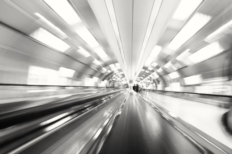 Architecture Blurred Motion Built Structure City City Life Day Futuristic Illuminated Indoors  Long Exposure Modern Motion One Person People Real People Speed Technology The Way Forward Transportation Tunnel