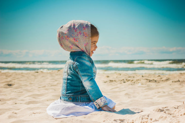 Beach Sea Sand Summer Kid Childhood Girl Land Water Child One Person Real People Leisure Activity Sky Lifestyles Casual Clothing Nature Innocence Day Focus On Foreground Sitting Horizon Over Water Outdoors