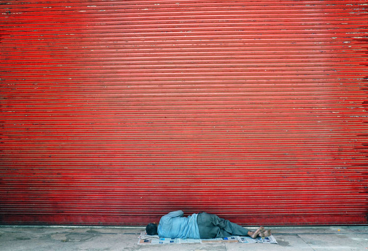 City Life EyeEm EyeEm Gallery EyeEmNewHere Eyeem4photography Poor  Red Architecture Brick Brick Wall Built Structure Day Footpath Iron Low Section Metal No People Outdoor Photography Outdoors Pattern Real People Red Sidewalk Sleeping Social Issues Streetphotography Urban Wall Wall - Building Feature The Photojournalist - 2018 EyeEm Awards The Street Photographer - 2018 EyeEm Awards #urbanana: The Urban Playground The Art Of Street Photography My Best Photo