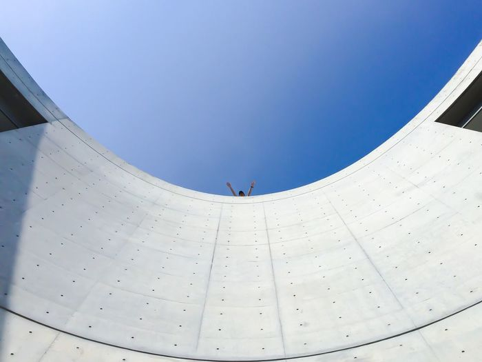 Low angle view of built structure against clear blue sky