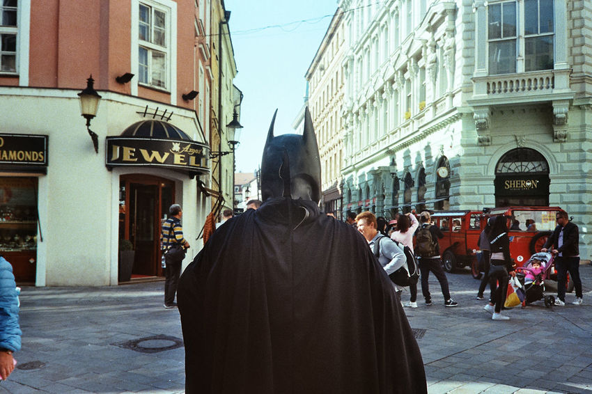 Batman Costume Streetphotography Streetview Analogue Photography Film Photography Kodak City Men Walking Rear View Street Sky Architecture Building Exterior City Street