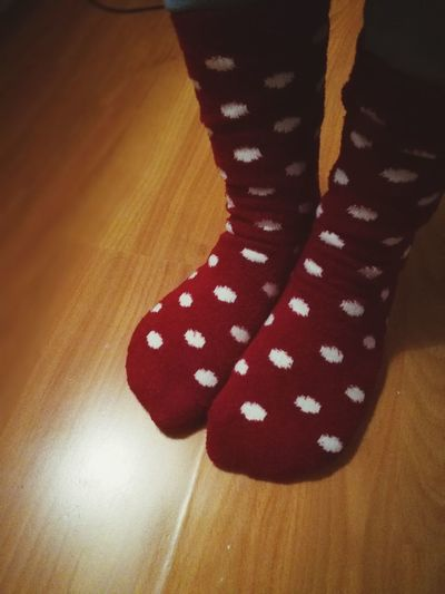 Indoors  Low Section Pattern Fashion Textile Spotted Human Leg Human Body Part Close-up One Woman Only Warm Clothing One Person Socks Christmas Time Christmas Red Color Pois Winter Clothes Christmas Clothing Feet