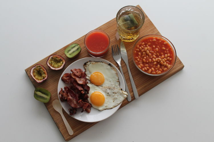 High Angle View Of English Breakfast On Cutting Board