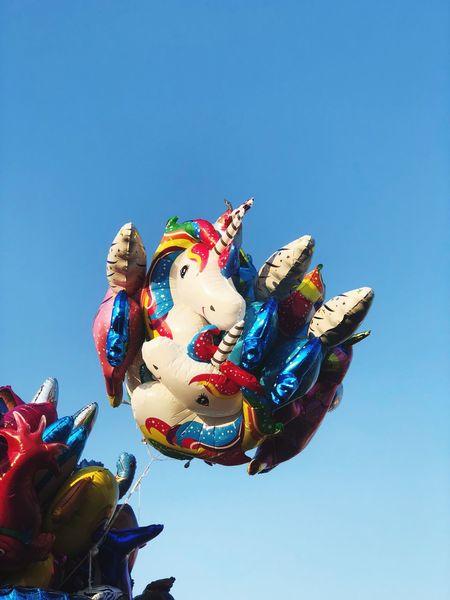 Fliegende Einhörner auf der Kirmes Cranger Kirmes  Cirmes Kirmes Representation Sky Clear Sky Animal Representation Low Angle View Art And Craft Celebration Day No People Decoration