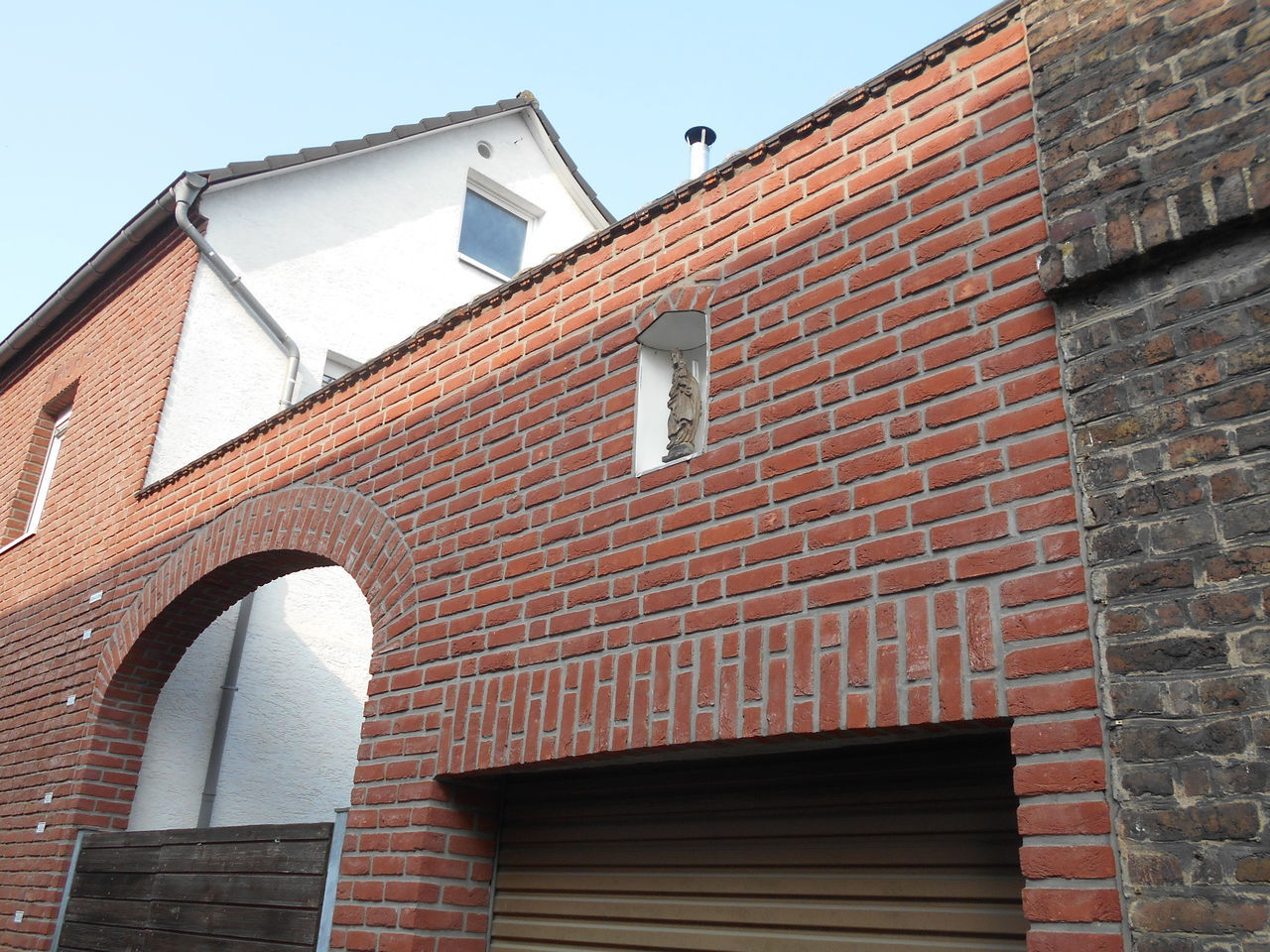 architecture, building exterior, built structure, brick wall, no people, window, low angle view, day, outdoors, sky