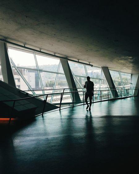 Front view of man walking in museum hallway