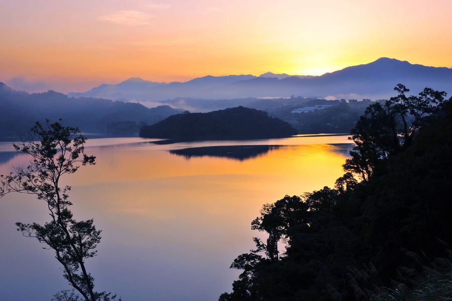 The faint color will be a romantic atmosphere Miaoli Taiwan Twilight Beauty In Nature Carp Pond Dawn Day Idyllic Landscape Mountain Mountain Range Nature No People Orange Color Outdoors Peaceful Scenics Silhouette Sky Sunset Tranquil Scene Tranquility Travel Destinations Tree Water