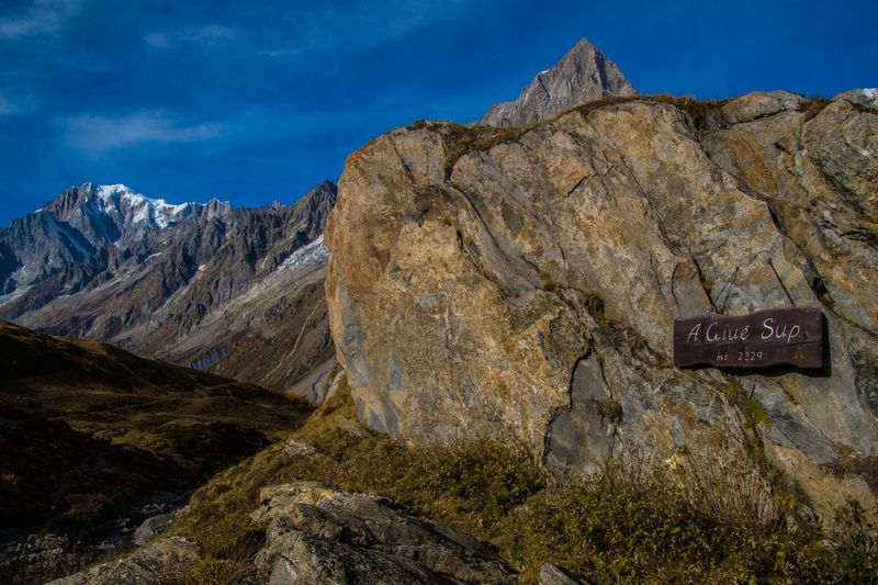mallatra,val ferret,courmayeur,italy Mountain Sky Rock Text Mountain Range Scenics - Nature Communication Solid Nature Rock - Object No People Beauty In Nature Day Cloud - Sky Sign Rock Formation Landscape Tranquil Scene Tranquility Non-urban Scene Outdoors Mountain Peak Formation