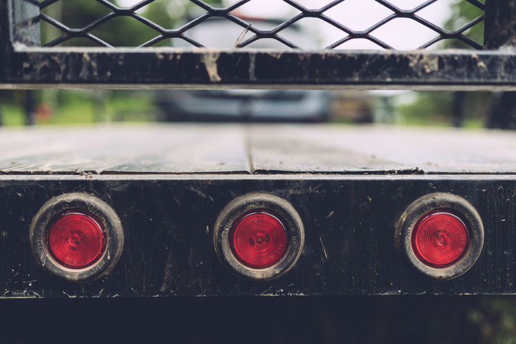 Cage Close-up Day Full Frame Land Vehicle Mode Of Transport No People Outdoors Red Red Lights Tail Lights Trailer Transportation