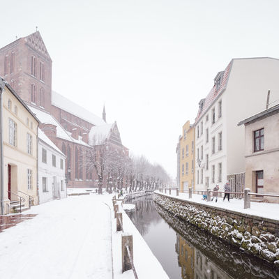 view of snow covered buildings in city Historical Building Mecklenburg-Vorpommern Winter Winterscapes Architecture Building Exterior Built Structure Clear Sky Cold Temperature Day Germany Nature No People Old Buildings Oldtown Outdoors Philipp Dase Sky Snow Snow Covered Transportation Weather Winter Winter In The City Wismar