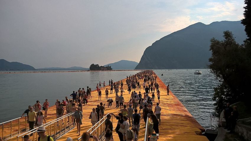 Beauty In Nature Christo Coastline Day Floating Piers Horizon Over Water Idyllic Mountain Nature No People Outdoors Remote Rippled Rock - Object Rock Formation Scenics Sea Sky The Way Forward Tourism Tranquil Scene Tranquility Travel Destinations Vacations Water