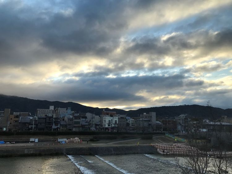 Good morning, Kyoto. Building Exterior Architecture Built Structure Sky City Water Cloud - Sky Residential Building Outdoors No People Waterfront Cityscape Mountain Nature Sea Beauty In Nature Storm Cloud Day Riverside River Kamogawa Daimonji Mountain Kyoto Luxury EyeEm