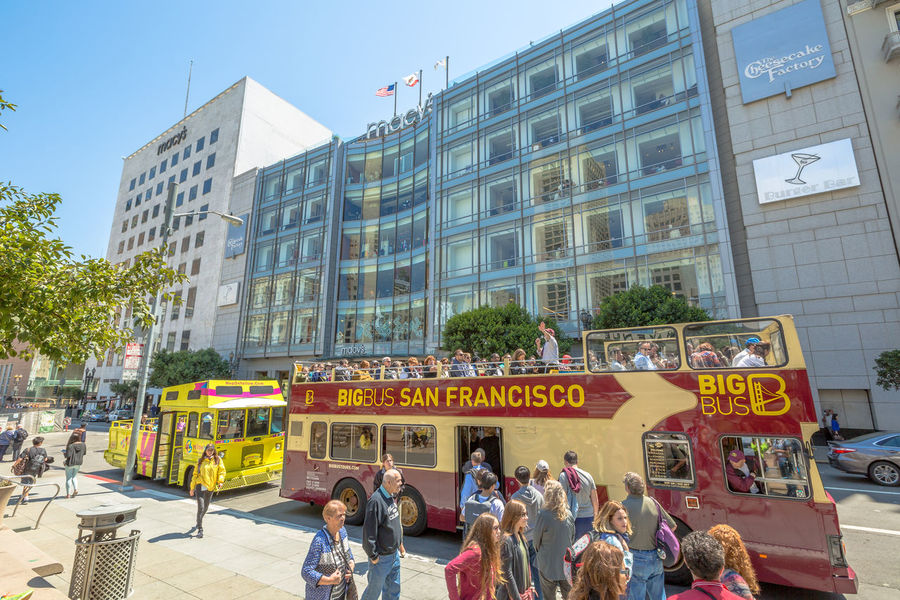 San Francisco, CA, United States - August 17, 2016: crowds of tourists in the popular Union Square, the central square of San Francisco on Market Street, known as the place shopping and luxury hotels. San Francisco, California, United States - August 17, 2016: the Big Bus, Hop On Hop Off, Sightseeing Tour, the popular double-decker bus carrying tourists, standing in Union Square, during a day tour. Cable Car California Market SF San Francisco Square Union Union Square SF United States Adult Architecture Building Exterior Built Structure City Crowd Day Large Group Of People Market Street San Francisco Market Street Men Outdoors People Protestor Real People Street Union Square  Unionsquare Women