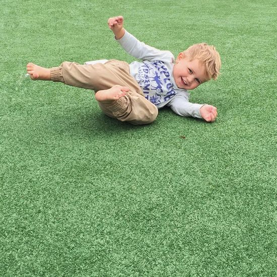 Rolling in laughter Child Rollingaround Laughter Barefoot Grass Golf Playing Games Golfgreen Carefree IPS2016People