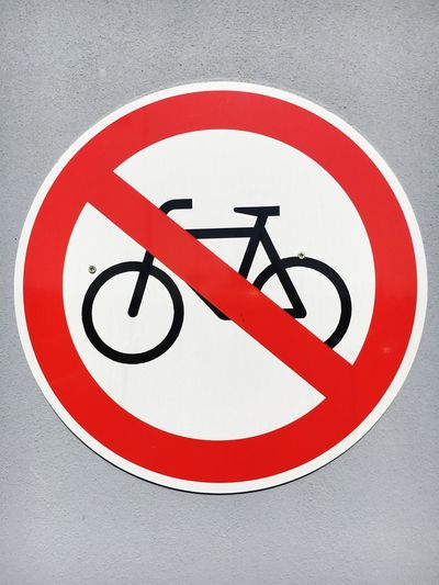 No bicycle parking sign on wall