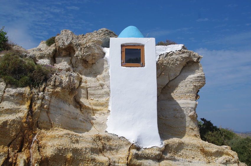 Griechenland Milos Island Architecture Bell Tower Building Exterior Built Structure Day Greece Low Angle View Milos Mountain Nature No People Outdoors Place Of Worship Religion Sky Sunlight Whitewashed