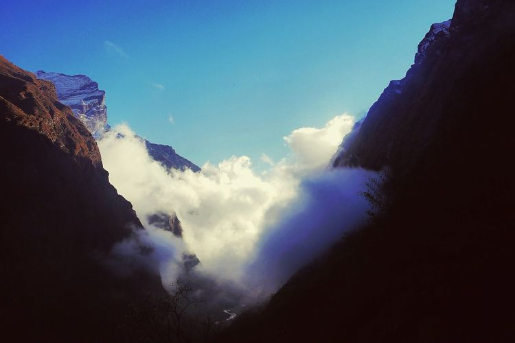 Clouds in Nepal Sky Nature Beauty In Nature Cloud - Sky Mountain Scenics Tranquility Tranquil Scene No People Blue Outdoors Day Low Angle View Nepal Valley Athmosphere Cold Temperature Travel