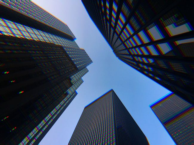 Architecture Built Structure Low Angle View Building Exterior Building Sky Modern Tall - High Office Building Exterior City Skyscraper No People Office Tower Illuminated Nature Pattern Multi Colored Clear Sky Glass - Material
