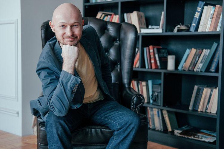 Portrait of man sitting in office