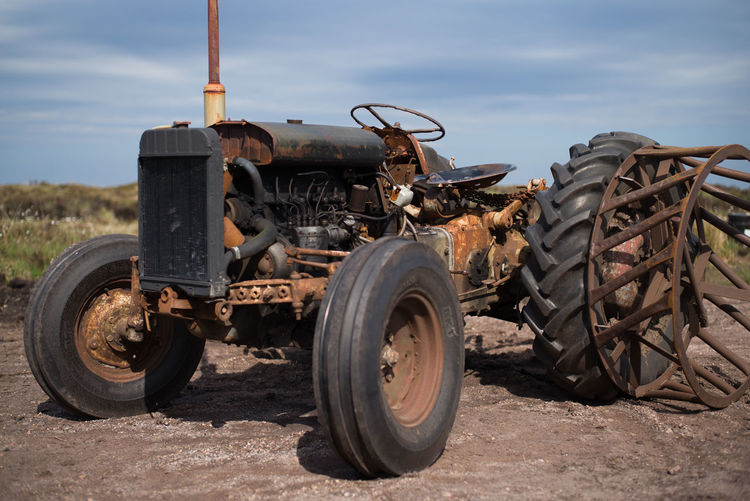 Old tractor Scotland Abandoned Agricultural Equipment Agricultural Machinery Damaged Day Decline Deterioration Field Islay Land Land Vehicle Metal Mode Of Transportation Nature No People Obsolete Old Outdoors Ruined Run-down Rusty Sky Tire Tractor Transportation Wheel