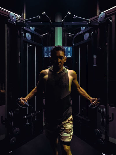 Portrait of man exercising at gym